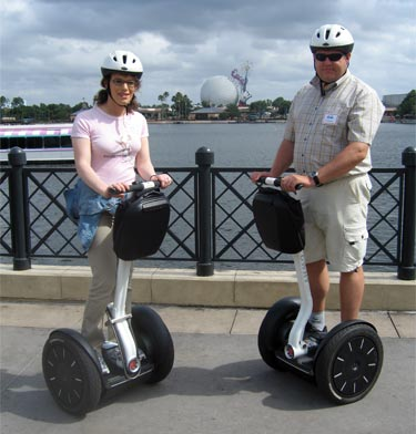 On Segways in the World Showcase area with the EPCOT ball in the background